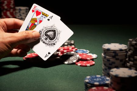 Blackjack hand of cards and casino chips  Editorial