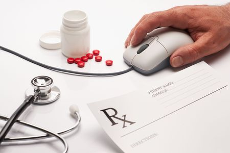 Prescription medicine and pharmacist hand on computer mouse photo