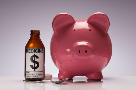 quantitative: Credit cruch pig with medicine representing quantitative easing