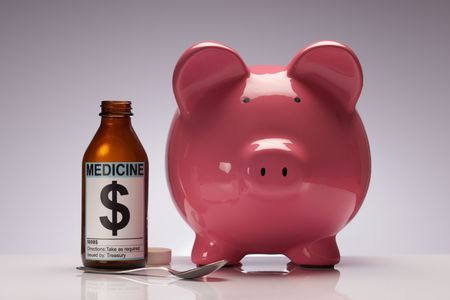 Credit cruch pig with medicine representing quantitative easing