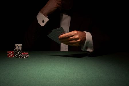Card player in casino about to play hand Stock Photo