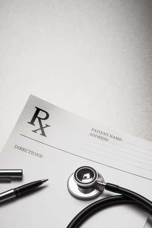 RX prescription form stethoscope and pen on stainless steel background