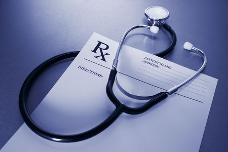 RX prescription form and stethoscope on stainless steel desk blue tone
