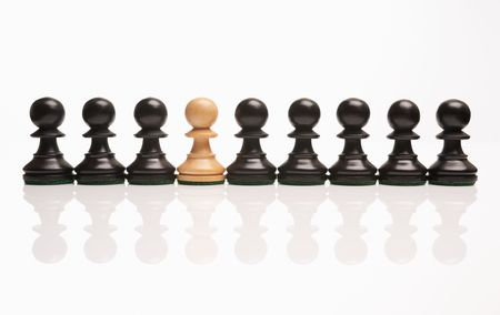 chess the odd one out white pawn in row of black pawns