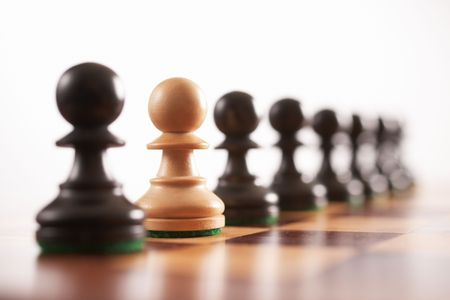 chess the odd one out white pawn in row of black pawns selective focus  Standard-Bild