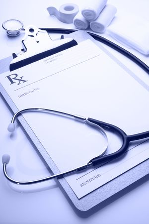 rx prescription on clipboard with stethoscope blue tone  Stock Photo