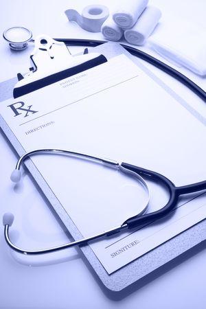 rx prescription on clipboard with stethoscope blue tone  Standard-Bild