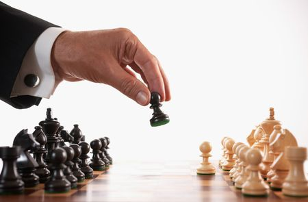 hand move: businessman playing chess game selective focus back makes first move Stock Photo
