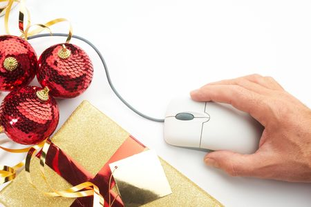 Online internet Christmas shopping concept with present computer mouse and hand  photo