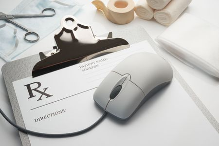 Online rx prescription concept clipboard with stethoscope and bandages