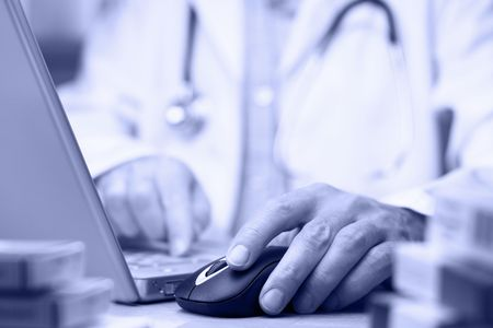 Doctor preparing online internet medical record blue tone