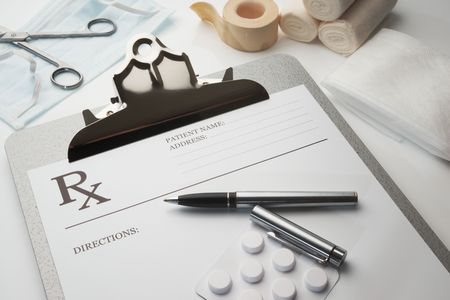 Online rx prescription concept pills pen stethoscope and bandages Stock Photo