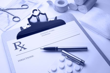 Online rx prescription concept pills pen stethoscope and bandages blue tone Stock Photo