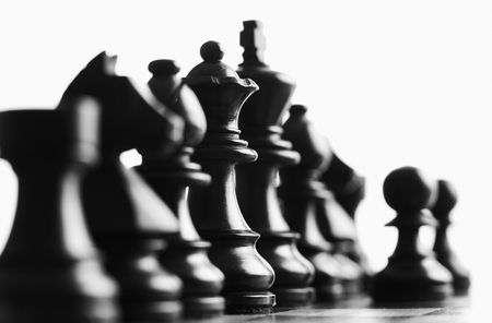 bishop chess piece: Close up of black chess pieces foucs on the queen Stock Photo