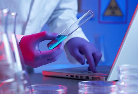Close up of biotechnology research in laboratory blue lighting