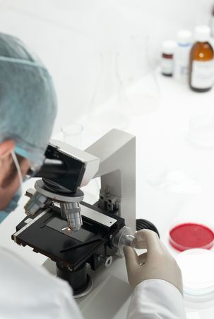 Scientist conducting genetic research of blood sample in laboratory selective focus Standard-Bild