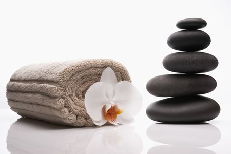 close up of spa treatment luxury treatment with hot stones and orchid  Stock Photo - 7000194