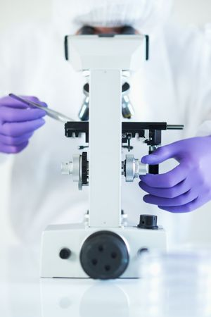 Forensic scientist examined evidence under microscope selective focus