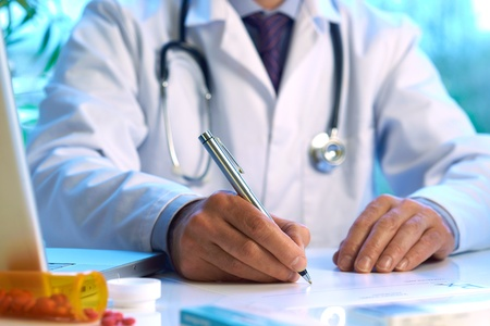 doctor laptop: Doctor writing prescription selective focus  Stock Photo
