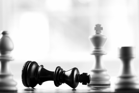 chess board: Checkmate white defeats black king selective focus