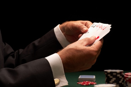 Poker player gambling casino chips on green felt background selective focus
