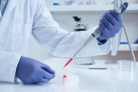 pipette: Scientist processing DNA sample in laboratory selective focus  Stock Photo