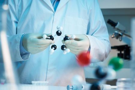 Scientist holding molecular model selective focus