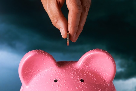 rainy day: Saving for a rainy day piggy bank saving concept Stock Photo