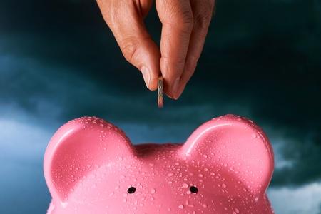Saving for a rainy day piggy bank saving concept Stock Photo