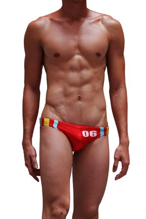 A well-toned man in a pair of red swimming trunks