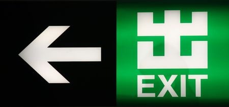 Exit Sign in both Chinese and English Stock Photo