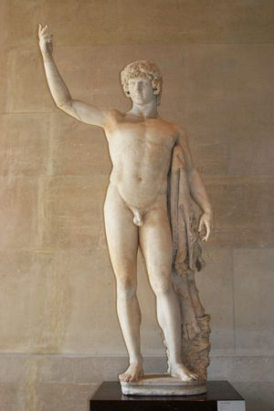 Greek male statue in louvre museum, Paris Stock Photo