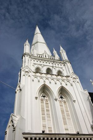 andrew: St Andrew Church in Singapore over a blue sky background