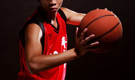 nba: A young basketball player in red jersey
