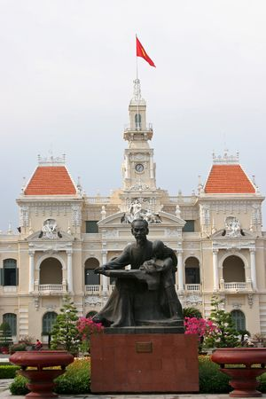 Peoples committee building in Ho Chi Minh City, Vietnam with Ho Chi Minh Statue in front Stock Photo
