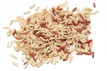 unpolished: Unpolished Rice over white background Stock Photo