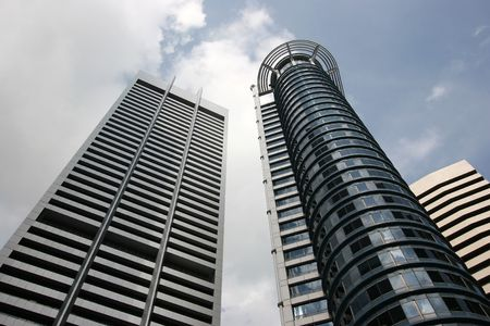 commercial building in the central business district of Singapore under impending storm