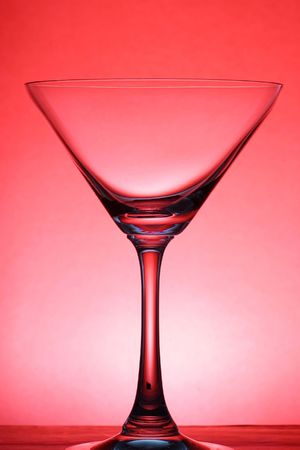 A cocktail glass over red background Stock Photo