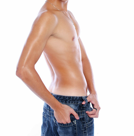A turning asian male body in blue jeans photo