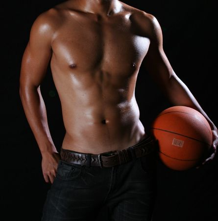 Asian hunky basketball player in blue jeans Stock Photo