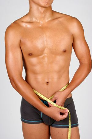 a semi- hunky asian male with a measuring tape around his waist photo