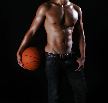 manhood: a hunky asian basketball player in jeans Stock Photo