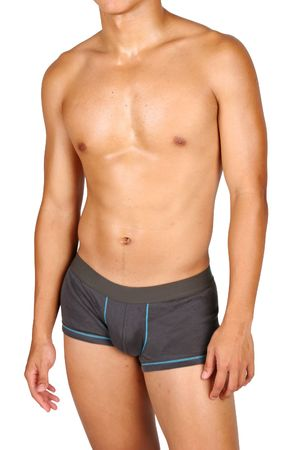 a hunky asian male in box trunks over white background photo