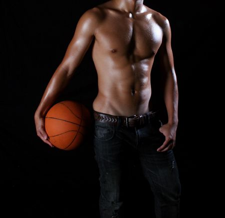 a hunky asian basketball player with a ball in hand