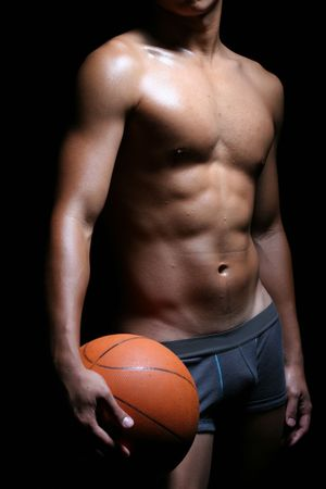 a hunky asian basketball player in boxer trunks