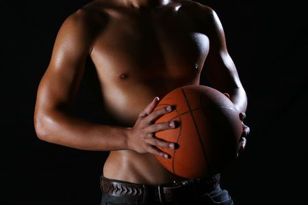bod: A young asian basketball player holding a basketball in his hands