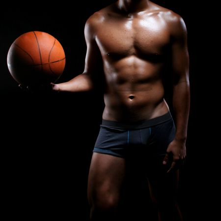 manhood: young and hunky asian basketball player in boxer trunks