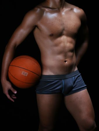 bod: hunky young asian basketball player in blue boxer trunks Stock Photo