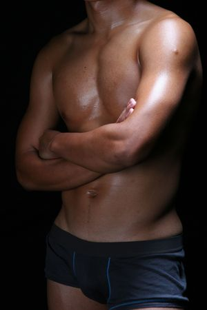 the profile view of a hunky young asian man in blue boxer trunks