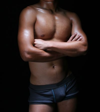 front view of the body of a hunky young asian in blue trunks